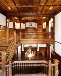 The second floor landing gives a glimpse of the rich construction with its ornate oak staircase.