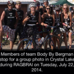 Members of team Body By Bergman stop for a group photo in Crystal Lake during RAGBRAI on Tuesday, July 22, 2014.